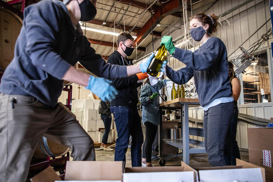 Employees bottle one of Odell's newest products: wine